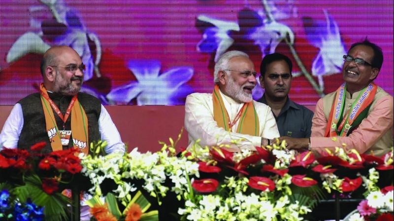 Prime Minister Narendra Modi, flanked by BJP president Amit Shah and Madhya Pradesh chief minister Shivraj Singh Chouhan, during the BJP's 'Karyakarta Mahakumbh' in Bhopal. (Photo: PTI)