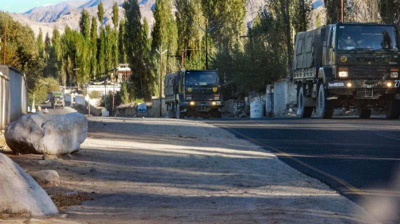 Army vehicles move towards eastern Ladakh amid the prolonged India-China stand off, in Leh, Tuesday.
