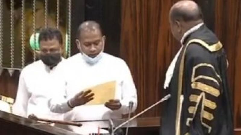 Premalal Jayasekera taking oath as lawmaker.