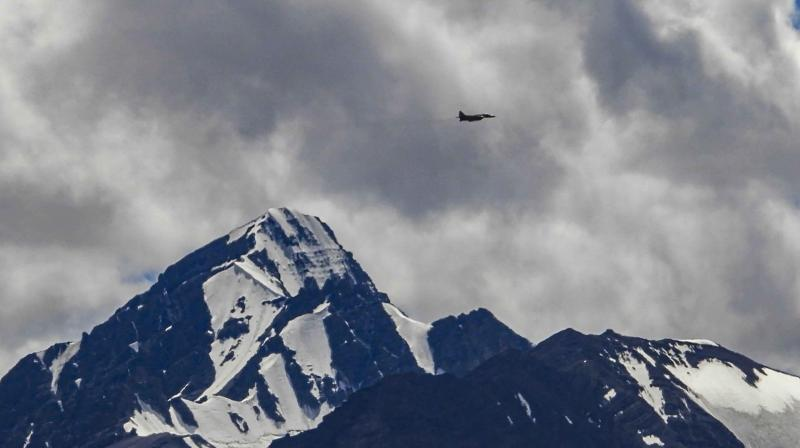 An IAF fighter jet flies over the UT amid the prolonged India-China stand off in the region, in Ladakh, Sunday. (PTI)