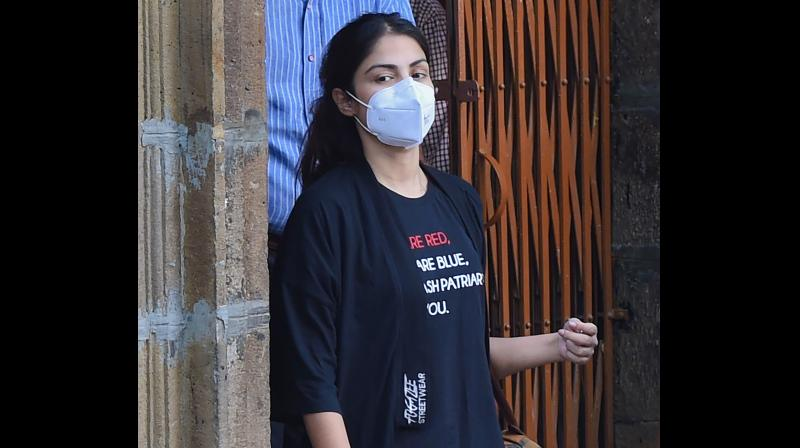 Narcotics Control Bureau officers take Bollywood actress Rhea Chakraborty, who has been sent in judicial custody till September 22 by a local court, to Byculla women jail, in Mumbai, Wednesday, Sept. 9, 2020. (PTI)