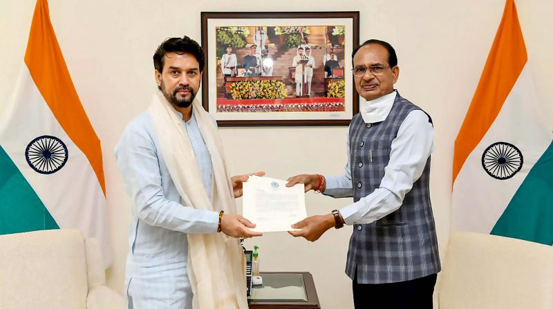 Chief Minister of Madhya Pradesh, Shri Shivraj Singh Chouhan meets the Union Minister for Information & Broadcasting, Youth Affairs and Sports Anurag Singh Thakur, in New Delhi, Thursday, July 29, 2021. (PIB/PTI)