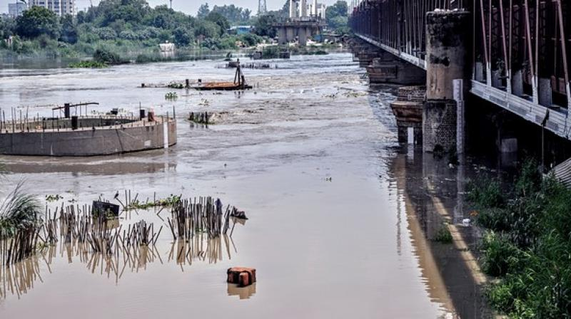The Delhi Police and the East Delhi district administration have been evacuating people living on the floodplains of the Yamuna. (ANI)
