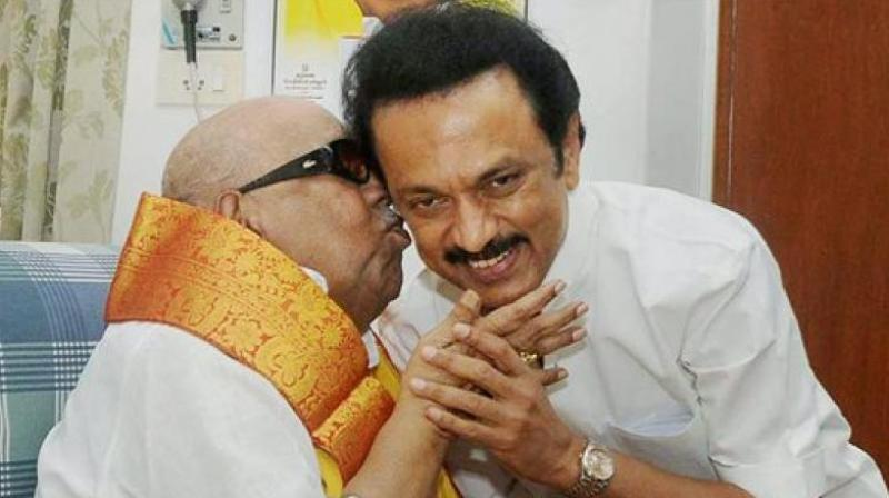 DMK chief M Karunanidhi with his son MK Stalin on his 63rd birthday in Chennai on March 1, 2015. (Photo: PTI)