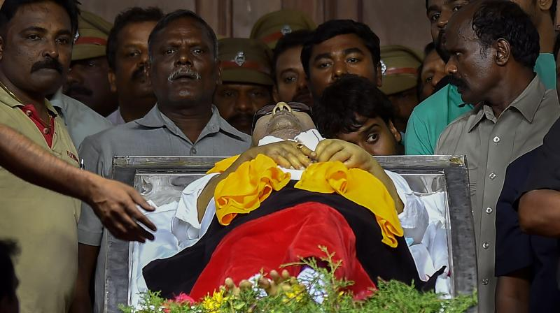 Party supporters pay their last respect to DMK chief M Karunanidhi at Rajaji Hall, in Chennai on Wednesday. (Photo: PTI)