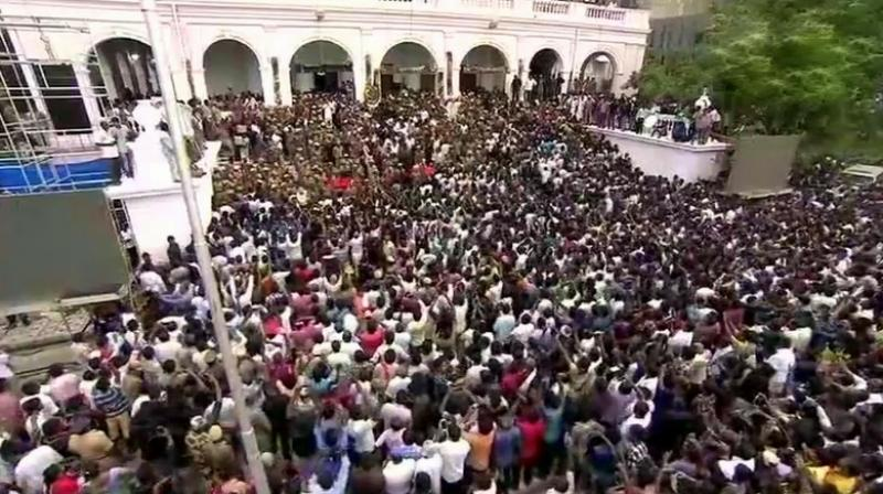 Several people have suffered injuries in the stampede that happened when the police were allowing them to enter the Rajaji Hall in batches. (Photo: Twitter | ANI)