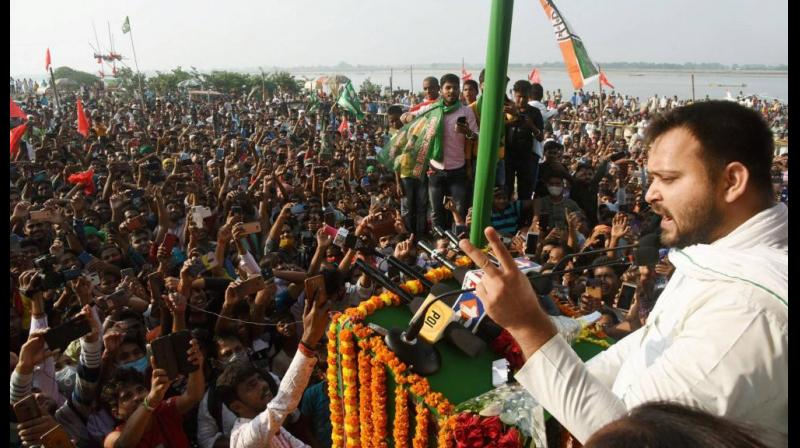 RJD leader Tejashwi Yadav addresses an election rally ahead of the Bihar Assembly polls at Digha in Patna, Sunday, Nov. 1, 2020. (PTI Photo)