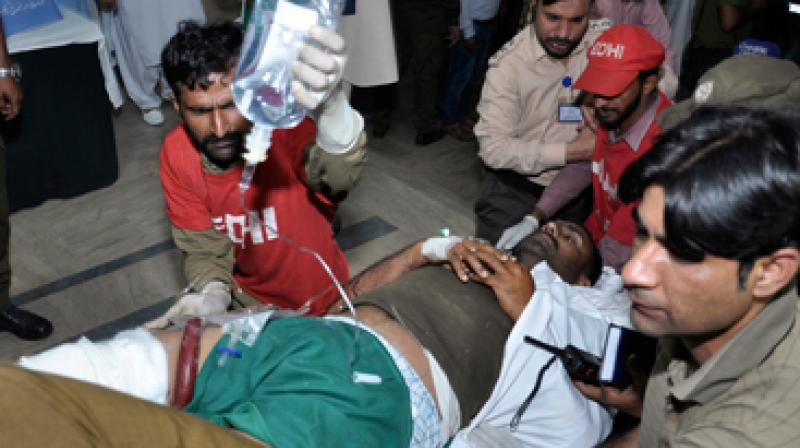 'Around 14 were policemen among the 25 who were injured in the blast. The condition of four policemen is stated to be critical,' Rescue 1122 spokesman Jam Sajjad said. (Photo: AP)