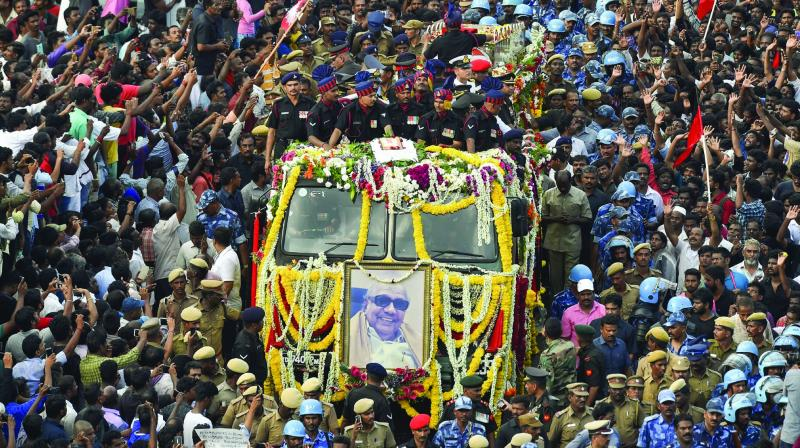 People gather to pay their last respects to DMK chief M. Karunanidhi as his cortege passes through the streets of Chennai on Wednesday. DMK leader M.K. Stalin. (Photo: Asian Age)