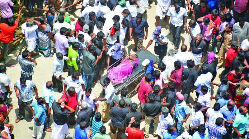 A woman injured in the stampede being carried out in a stretcher.(Photo: Asian Age)