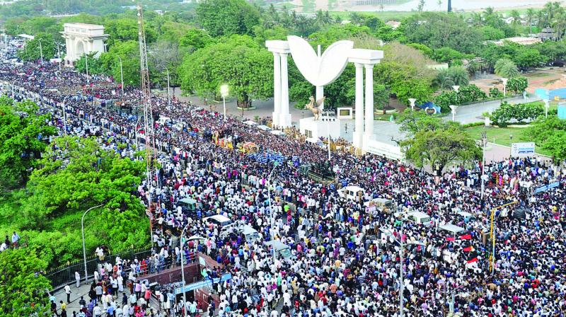 People gather to pay their last respects to DMK chief M. Karunanidhi near Marina Beach in Chennai on Wednesday. (Photo: Asian Age)