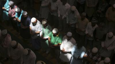 Men are seeing praying in a mosque during the holy month of Ramadan. (Photo: AP/Rajesh Kumar Singh)