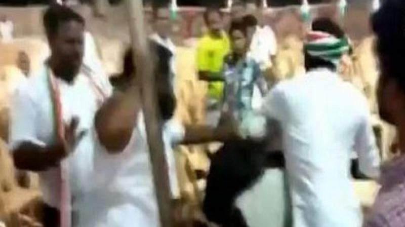Enraged with the lensmen, a few congress party workers misbehaved with photojournalists and began to thrash them. (Photo: ANI)