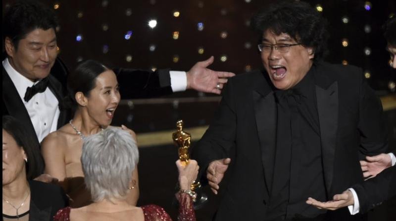 Bong Joon Ho after being presented with the award for best picture for
