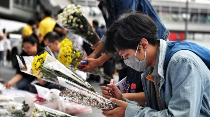 Mourners lay flowers at the Terminal 21 shopping mall, where a mass shooting took place, in the Thai northeastern city of Nakhon Ratchasima. AFP photo