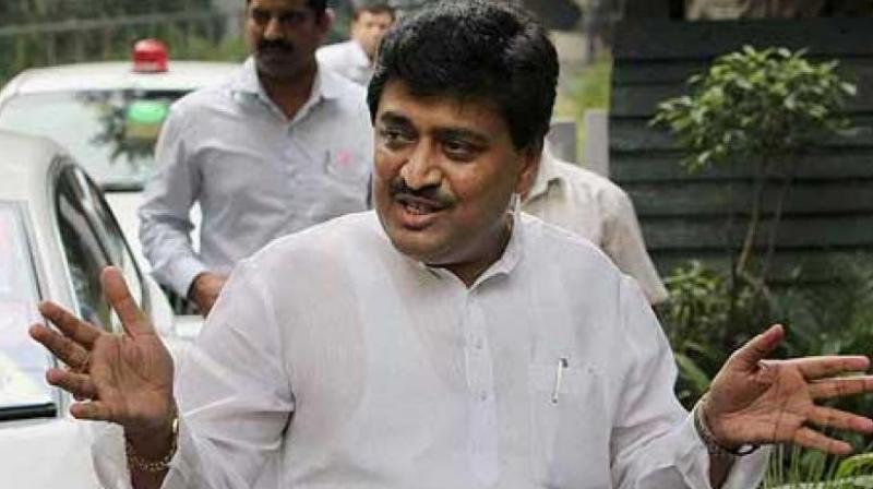 Maharashtra Congress chief Ashok Chavan broke a 'dahi handi' (an earthen pot), symbolising the alleged 'sins' of the two governments, while leading the protest at Karad here in the state. (Photo: File)