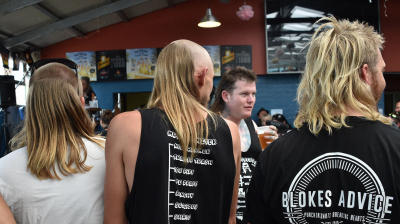 Men wait to be judged on their mullet hairstyles at Mulletfest 2018 in the town of Kurri Kurri, 150 kms north of Sydney on February 24, 2018. (Photo: AFP)