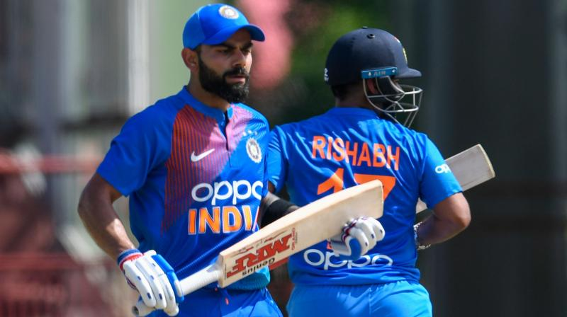 India captain Virat Kohli on Thursday backed the under-fire Rishabh Pant, asserting that he wouldn't let the young wicketkeeper-batsman feel isolated. (Photo: AFP)