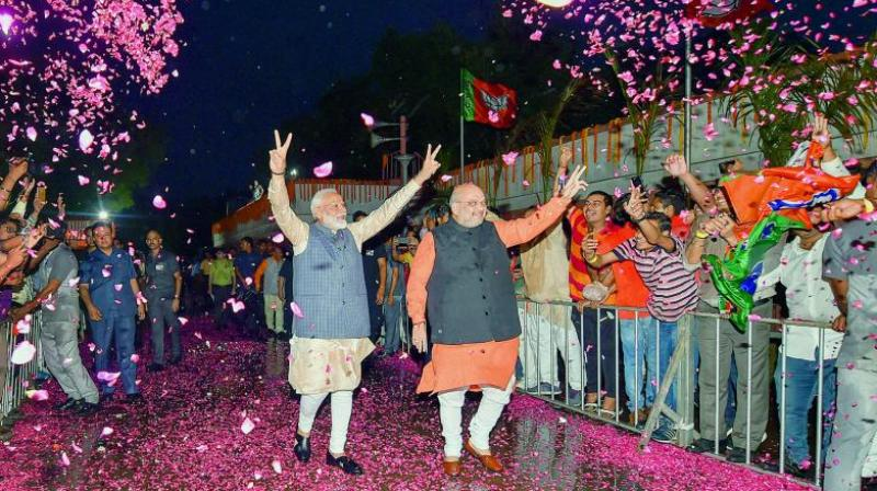 Bharatiya Janata Party workers welcome Prime Minister Narendra Modi as he, along with BJP president Amit Shah, arrives at the party headquarters to celebrate the party's victory in the Lok Sabha elections in New Delhi (Photo: AP)