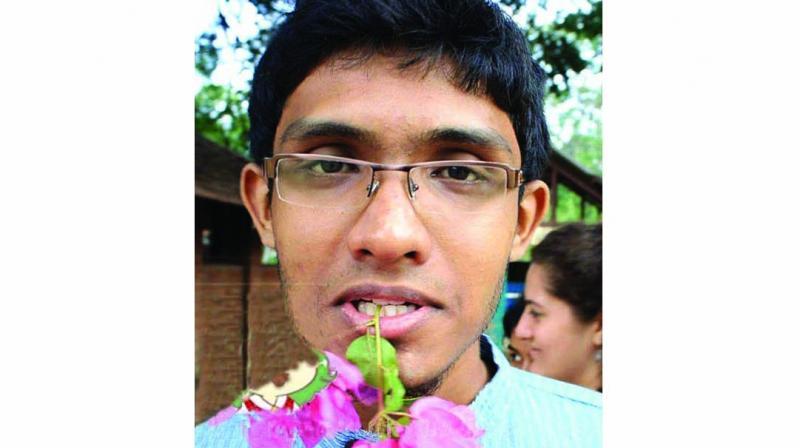 A JNU student, Rishi Joshua Thomas