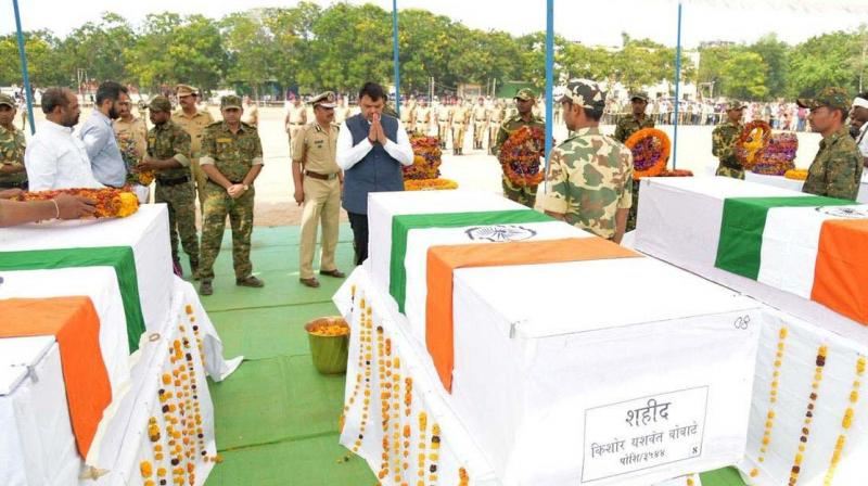 A file photo of chief minister Devendra Fadnavis paying his respects to the 40 jawans who were killed in the May 1 attack in Gadchiroli.