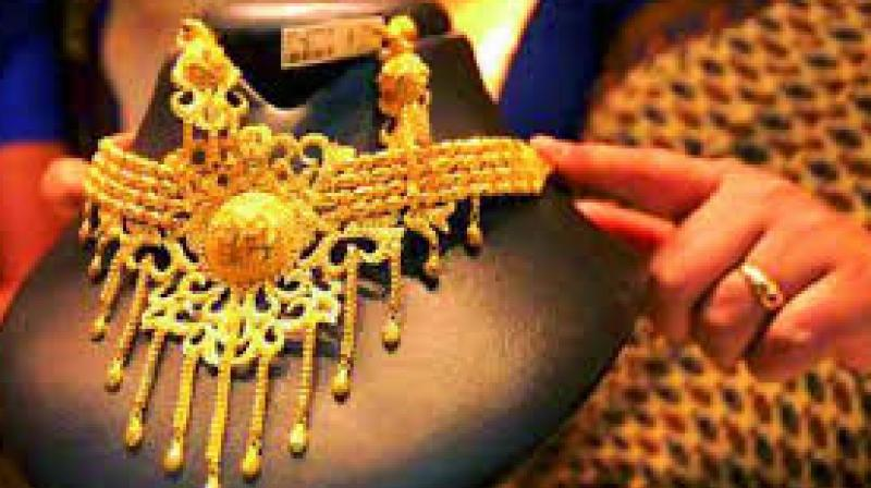 Gold prices went down by Rs 190 to Rs 30,740 per 10 grams at the bullion market on Friday, tracking a weak trend overseas amid fall in demand from the local jewellers.