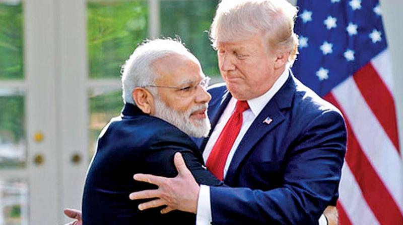 Prime Minister Narendra Modil embraces U.S. President Donald Trump. (Photo: AP)