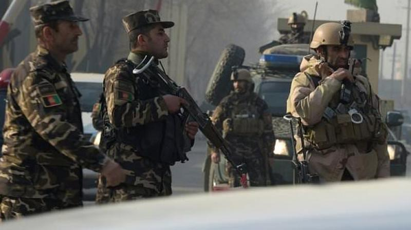 A suicide attacker on foot blew himself up near a compound belonging to the Afghan intelligence agency in Kabul, killing six civilians.