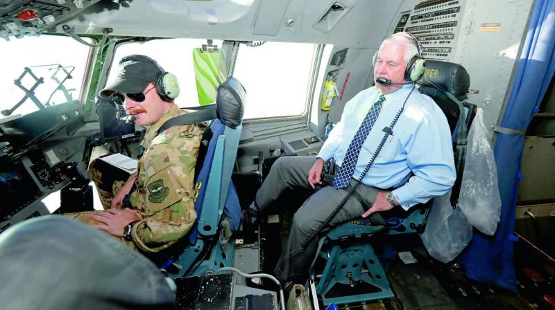Secretary of state Rex Tillerson talks with the pilots as he sits in the cockpit of C-17 aircraft on Monday on the way to Bagram Air Base, Afghanistan. (Photo: AP)