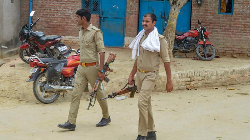 Police personnel during a search operation near the residence of main accused in the Kanpur encounter case, Vikas Dubey, in Kanpur. PTI photo