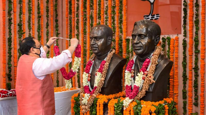 BJP National President JP Nadda pays tribute to Bharatiya Jan Sangh leaders Syama Prasad Mookerjee and Pt Deen Dayal Upadhyay on the occasion of the former's birth anniversary, at BJP HQ in New Delhi. PTI photo