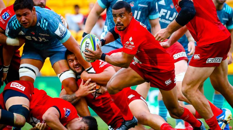 Sunwolves' Rudy Paige is tackled during the Super Rugby match between Japan's Sunwolves and New Zealand's Crusaders in Suncorp Stadium in Brisbane last weekend. AFP Photo