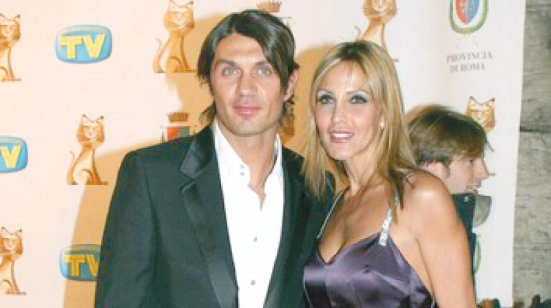 Paulo Maldini, who was known for handsome looks, flowing locks and easy style of play, with his wife. DC File Photo