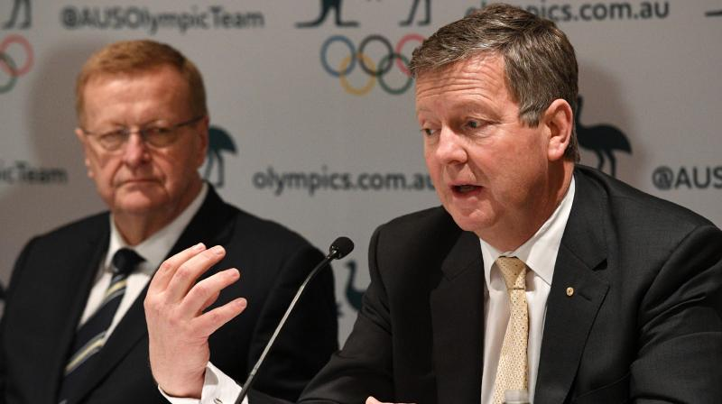 In this file photo, Australian Olympic Committee (AOC) chief executive officer Matt Carroll (R) and AOC president John Coates address a press conference where they reaffirmed plans to send athletes to Tokyo 2020. AFP Photo