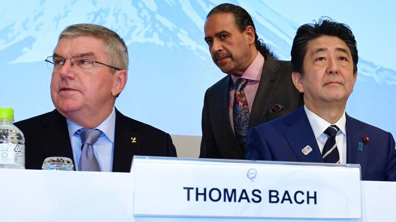 In this file photo International Olympic Committee (IOC) president Thomas Bach (L), Japan's Prime Minister Shinzo Abe and Association of National Olympic Committees (ANOC) president Sheikh Ahmad al-Fahad al-Sabah attend the XXIII ANOC General Assembly in Tokyo. AFP Photo