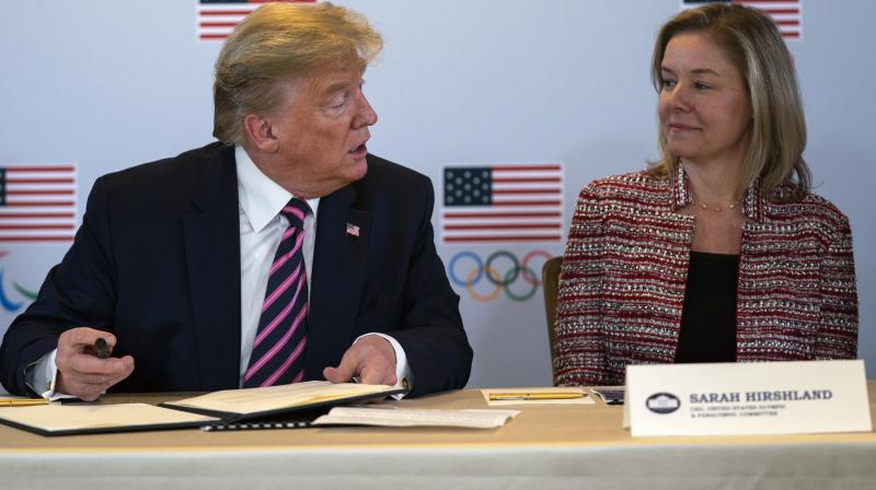 In this file photo, President Donald Trump speaks with CEO of the United States Olympic and Paralympic Committee Sarah Hirshland Hirshland. AP Photo