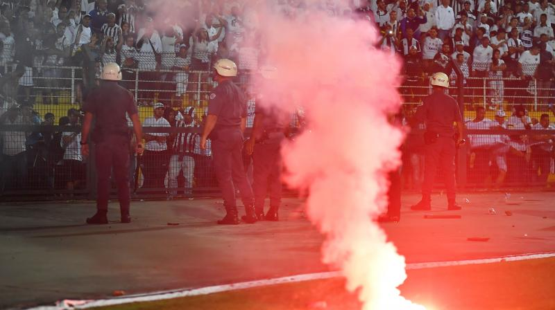 In this file photo taken on August 28, 2018 riot police are deployed to the stands where angry fans of Brazil's Santos shout slogans during the Copa Libertadores football match against Argentina's Independiente at the Pacaembu Stadium in Sao Paulo, Brazil. AFP Photo