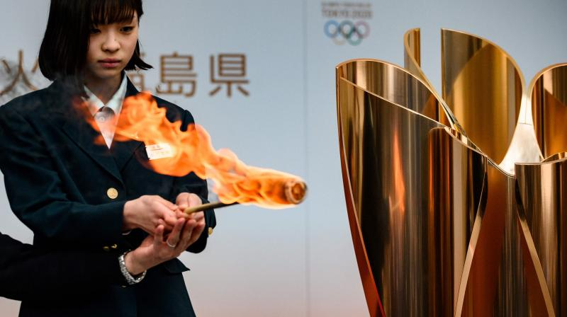 The Tokyo 2020 Olympic flame is displayed outside Fukushima railway station in Fukushima Prefecture. AFP Photo