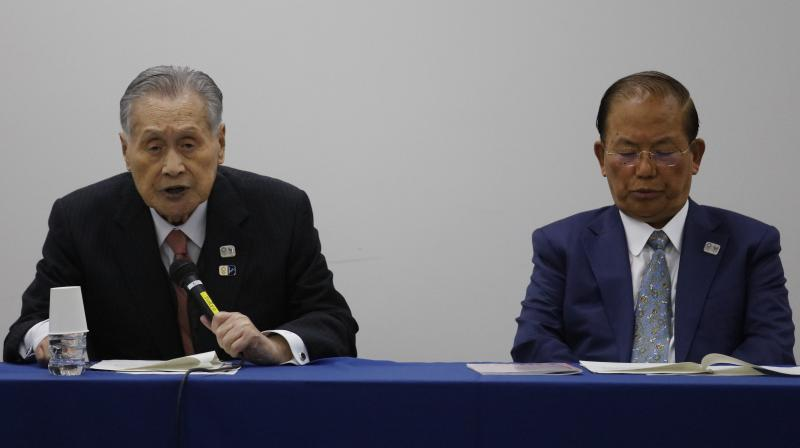 Tokyo 2020 Organizing Committee president Yoshiro Mori (L) and CEO Toshiro Muto at the news conference in Tokyo, Tuesday, where they announced the postponement of the Games until 2021 because of the coronavirus outbreak. AP Photo