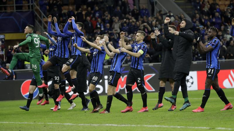 File photo of Atalanta players celebrating at the end of their Champions League round of 16, first leg, win over Valencia at the San Siro stadium in Milan, Italy, February 19. AP Photo