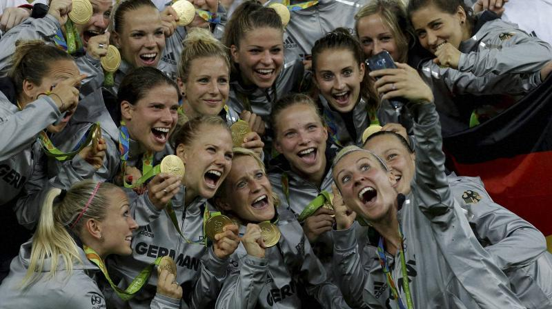 Germany women's football team pose for a selfie after receiving their gold medals for winning the Olympic football tournament final at the Maracana stadium in Rio de Janeiro, Brazil. AP Photo