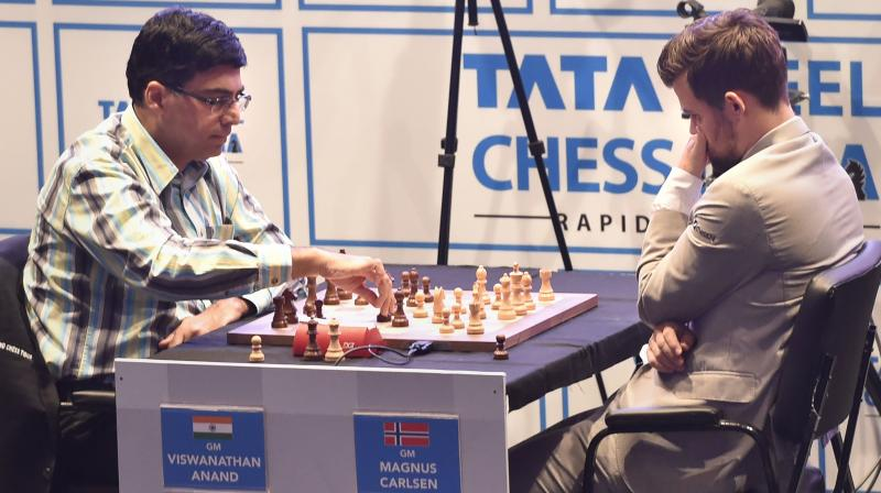 Former world champion Viswanathan Anand and current world champion Magnus Carlsen of Norway at the Tata Open. PTI Photo
