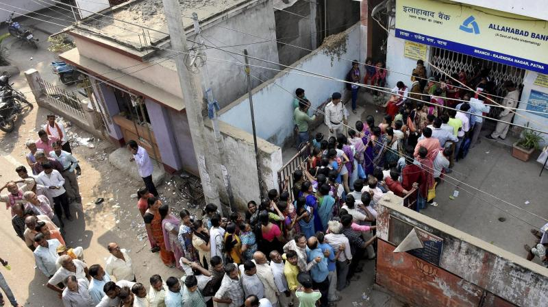 People queue up outside an ATM in Patna on Saturday. (Photo: PTI)