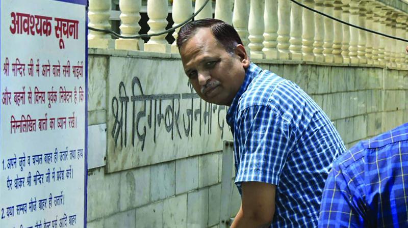 Delhi minister Satyendra Kumar Jain at a temple in New Delhi on Wednesday.(Photo: PTI)