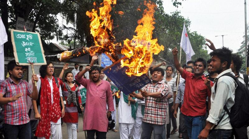 Activists of the Students Federation of India (SFI) burning the effigy of Education and Finance Minister Himanta Biswa Sarma at a protest against his comments on giving citizenship to Bangladeshi Hindus in Assam in Guwahati. (Photo: PTI)