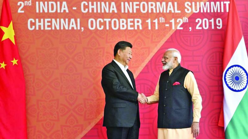 Prime Minister Narendra Modi with Chinese President Xi Jinping at Fisherman's Cove in Kovalam, near Mamallapuram, on Saturday. (Photo; PTI)