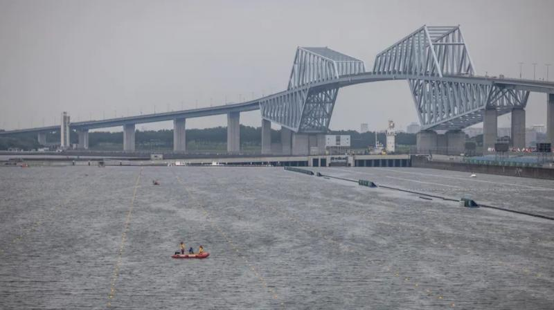 A rescue boat patrols the rowing course at Sea Forest Waterway after the venue was forced to close for competition Monday in Tokyo because of Tropical Storm Nepartak. (Photo: AP)