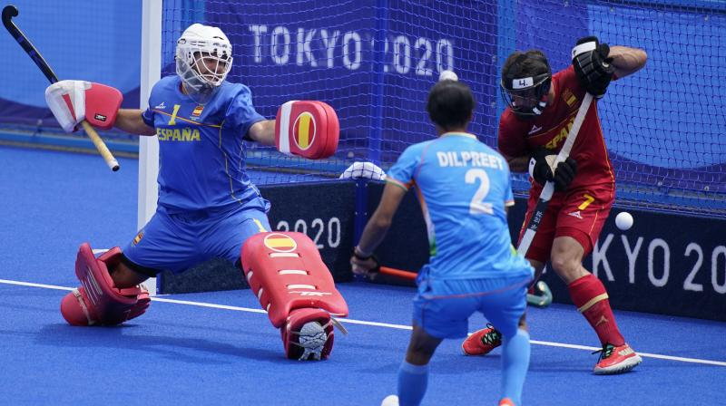 Spain goalkeeper Francisco Cortes Juncosa (1) and Spain's Miguel Delas de Andres (7) guard the goal against India during a Men's field hockey match at the 2020 Summer Olympics. (Photo: AP)