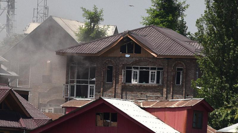 A house is left smouldering and damaged after yet another gunfight between security forces and militants in Srinagar. (File photo: Habib Naqash)