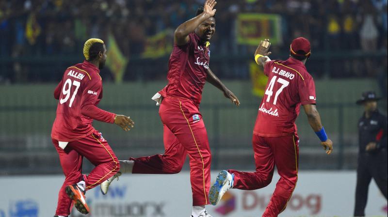 Oshane Thomas (centre) celebrates a wicket with his teammates during the Pallekele T20 match against Sri Lanka on Wednesday. AFP Photo
